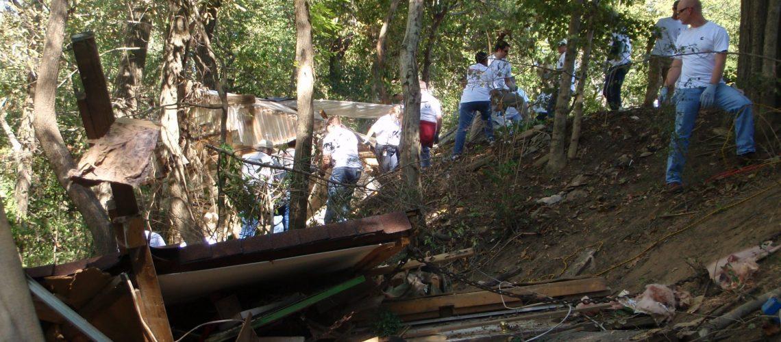 debris in beech bend with people in river bank